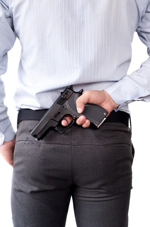 businessman and gun in hand photo