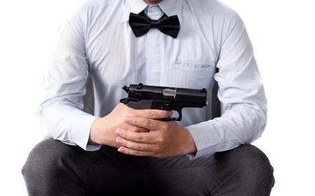 businessman and gun in hand photo