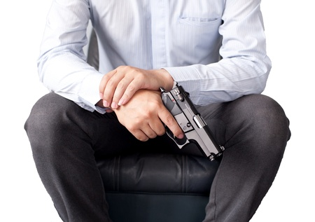 businessman and gun in hand Stock Photo