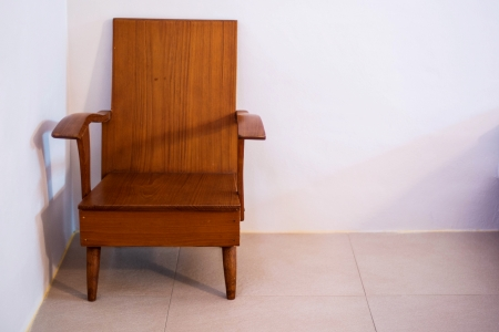 wood chair in room photo