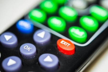 tv remote control,focus to  EXIT  and  OK  button photo