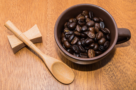 wood backgrounds: Coffee beans and cup on wood backgrounds Stock Photo