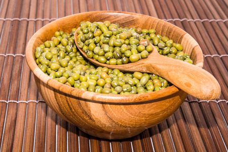 wood backgrounds: Mung bean on wood backgrounds Stock Photo
