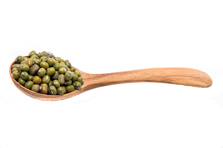 Green beans in wood spoons Stock Photo