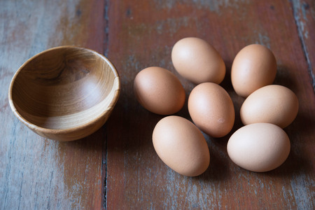 Eggs and wooden bowl