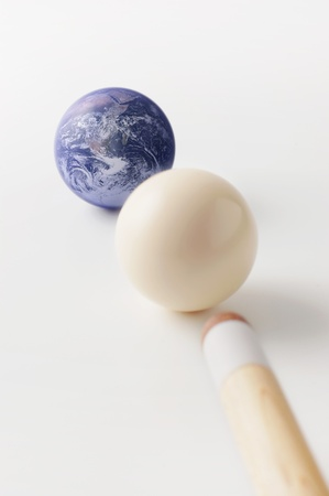 Earth and white pool balls with stick 写真素材