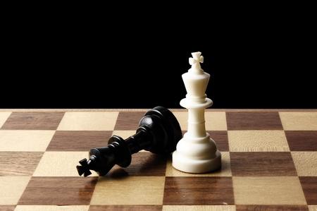 chessmen: Chessmen on a chessboard Stock Photo