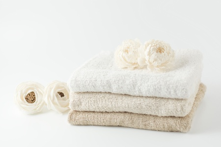 White flower and towels Imagens