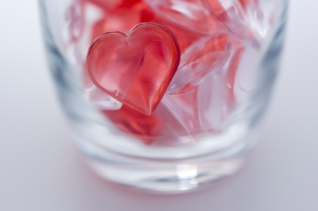 Small heart shape sundries in the glass photo