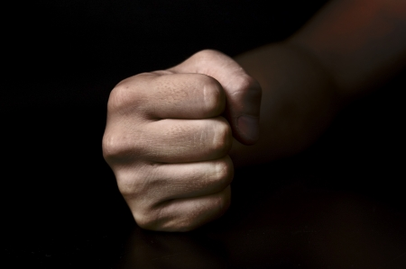 clenched: fist isolated on black background Stock Photo