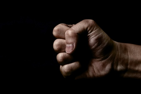 Clenched fist on black background