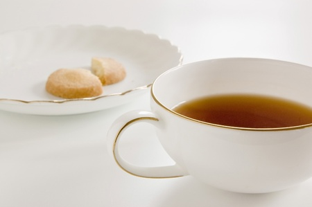 black tea in a cup. cookie on plate. photo