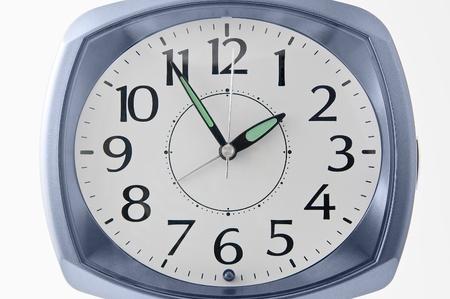 analog clock on white background photo