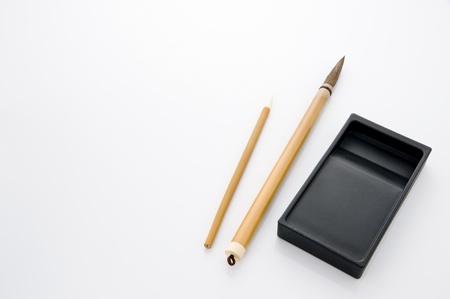 Writing brush and ink stone isolated on white background Stock Photo - 16153333