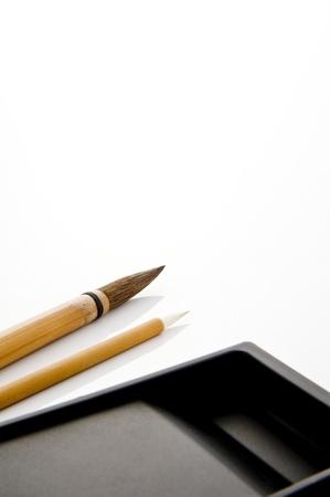 chinese calligraphy: Writing brush and ink stone isolated on white background