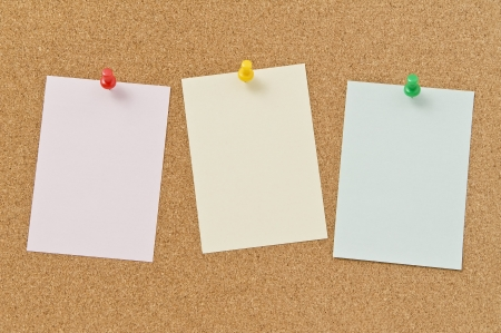Blank notepad pinned on corkboard, close up