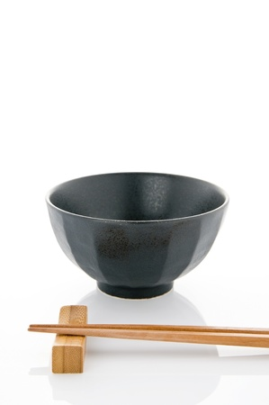 Rice bowl and chopsticks on white background Stock Photo