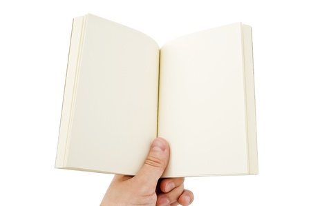 The hands holding a blank book photo