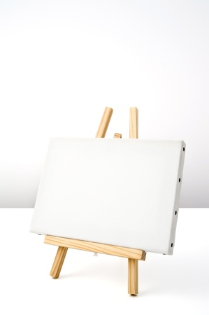 blank white canvas of painting tools on wooden easel Stock Photo - 16153740
