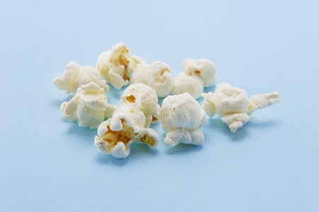 Popcorn on blue background photo