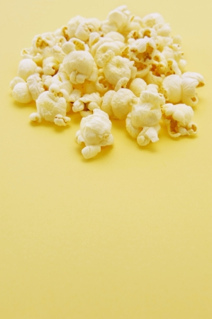 Popcorn on yellow background photo
