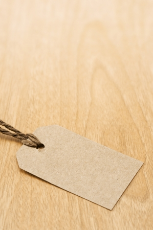Blank tag on wooden table photo