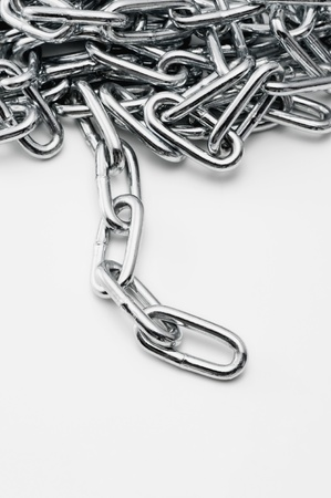 Iron chain on white background, close-up shoot Stock Photo - 16278114