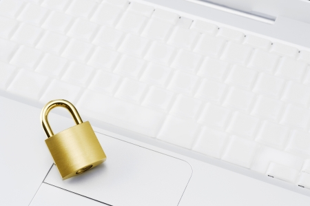 Personal computer with key board and gold padlock, close-up shoot Stock Photo - 16280749