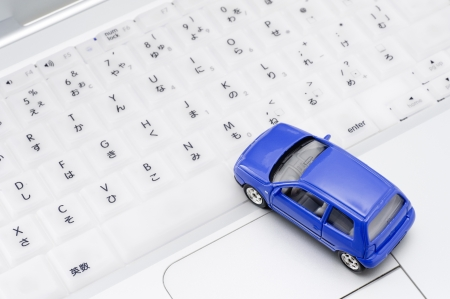 Personal computer and miniature car, close-up shoot  Stock Photo - 16282333