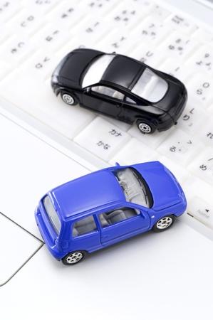 Personal computer and miniature car, close-up shoot  Stock Photo - 16282427