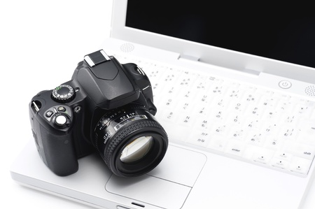 Notebook PC and SLR camera on white background Stock Photo - 16282199