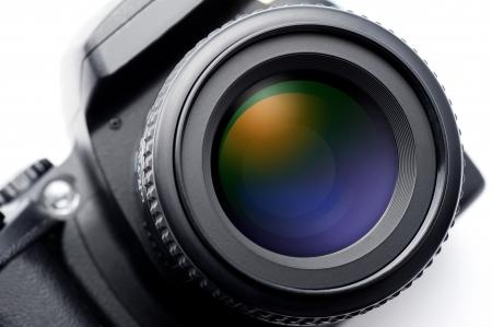 白い背景の上の一眼レフ カメラのレンズ 写真素材