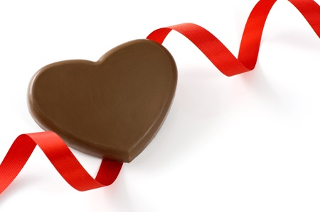 Heart shape chocolate with ribbon on white background