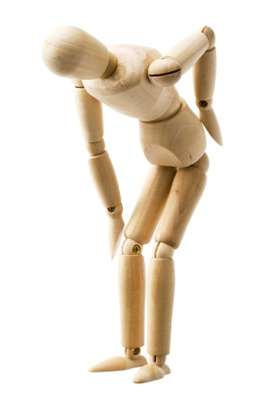 dolor de espalda: Madera pose títere aislado sobre fondo blanco