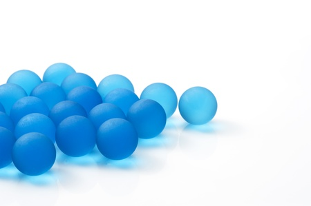 Many blue glass marbles on white background Stock Photo - 16315445