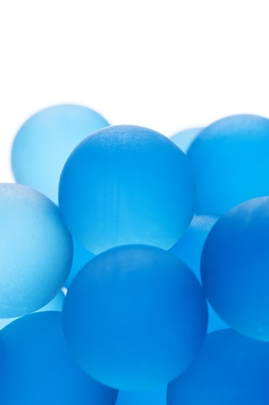 Background image of many blue glass marbles, close-up  photo