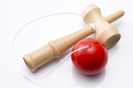 Classic wooden bilboquet with red ball of traditional toy Reklamní fotografie