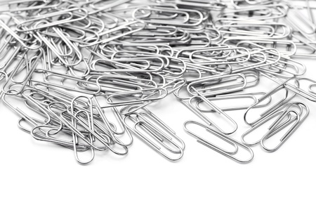 A lot of silver paper clip on white background Stock Photo - 16330517