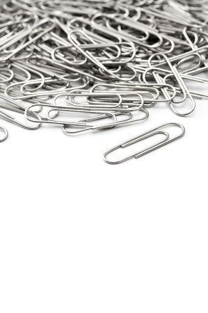 A lot of silver paper clip on white background  Stock Photo - 16330514
