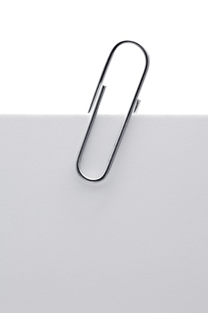 Memo pad and paper clip on white background Stock Photo - 16330511