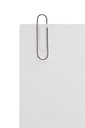 Memo pad and paper clip on white background Stock Photo - 16330509