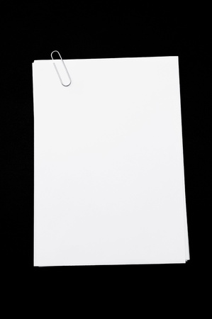 Memo pad and paper clip, high angle view Stock Photo - 16330510