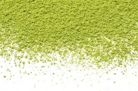 Maccha, dried powder green tea on white background