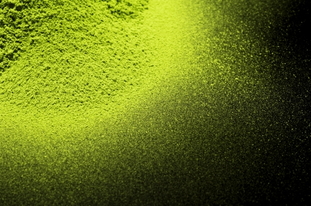 Maccha, dried powder green tea on black background