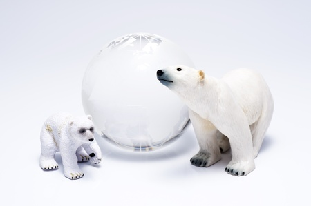 Polar bear family dolls and clear glass globe  photo