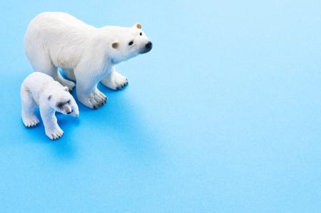polar light: Polar bear family dolls on light blue backgrounc