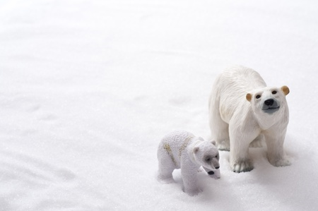 toy bear: Polar bear family dolls on snow background  Stock Photo