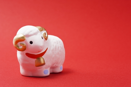 sheep, japanese new year image on red background  Stock Photo