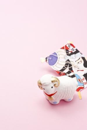 ovine: sheep, japanese new year decoration on pink background