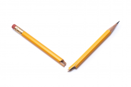 relent: Broken pencil pencil on white background, close-up